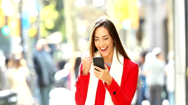 Excited woman receiving good news online