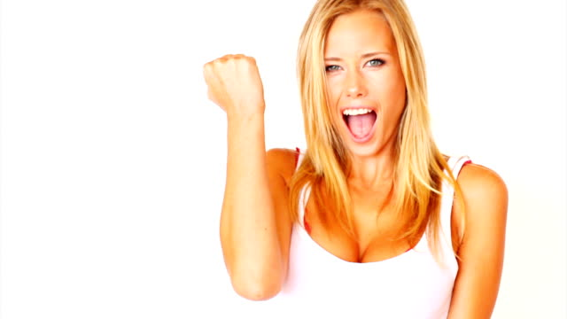 Excited young lady celebrating success video