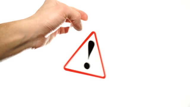 Exclamation mark sign isolated. Male hand showing warning sign