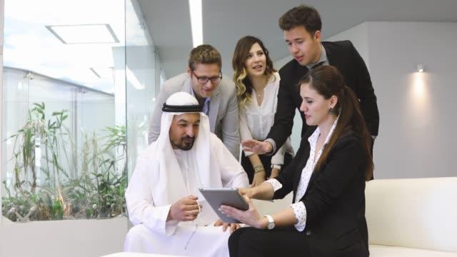 executive business team having conversation with a arab businessman - arab стоковые видео и кадры b-roll