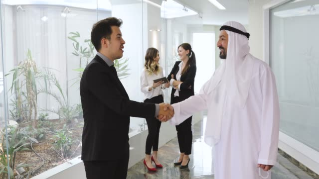 Executive Businessman shaking hands with a Arab Businessman