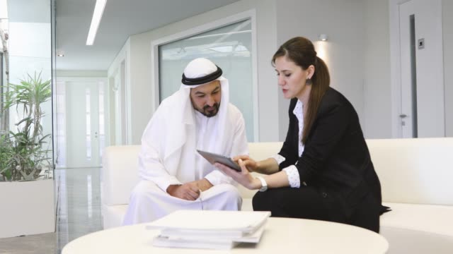Executive Businesswoman having conversation with a Arab Businessman