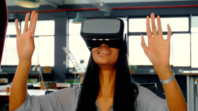 Executive using virtual reality headset in the office 4k Female executive using virtual reality headset in the office 4k saleswoman stock videos & royalty-free footage