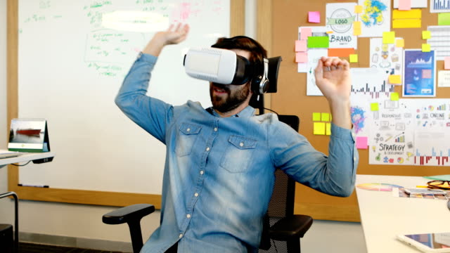 Executive using virtual reality headset video