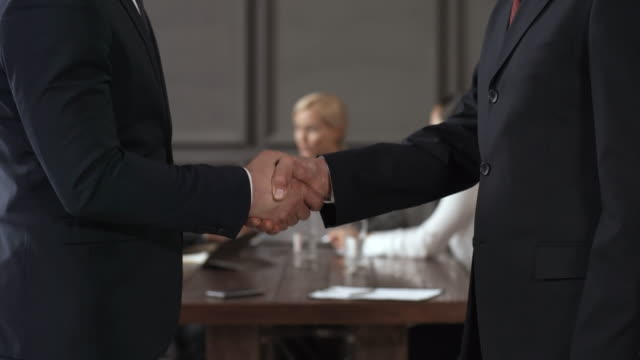 Executives Arriving for Meeting and Shaking Hands