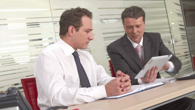 HD: Executives Using Digital Tablet For Business video