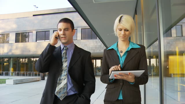 HD STEADY: Executives Walking On Office Walkway video