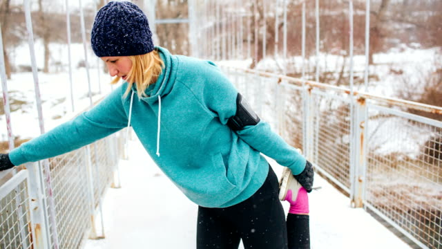 Exercise on a snowy winter day video