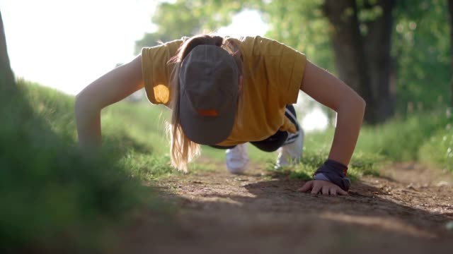Exercising in the forest Sports woman doing push ups in the forest push ups stock videos & royalty-free footage
