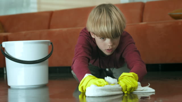 HD: Exhausted Boy Scrubbing The Floor HD1080p: CLOSE-UP shot of an exhausted little boy scrubbing the floor. Child labor theme. chores stock videos & royalty-free footage