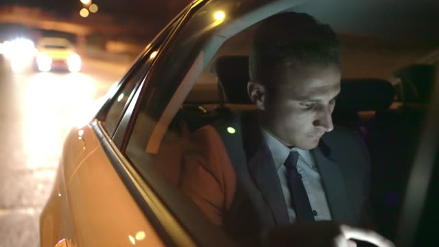 MS Exhausted businessman on the back seat of a car video