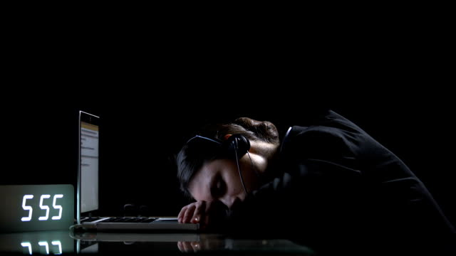 exhausted lady office worker sleeping on laptop, suffering extensive workload - shifts call centre video stock e b–roll