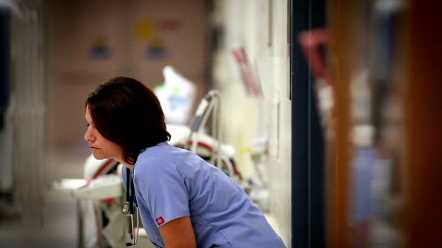 exhausted nurse - nurse stock videos & royalty-free footage
