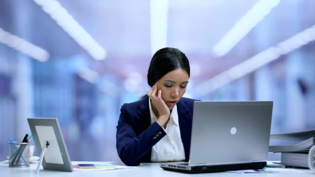 Exhausted secretary falling asleep on office desk, dreaming of home comfort