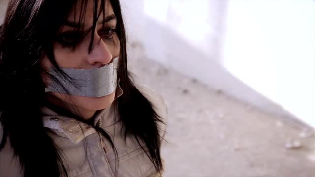vídeos y material grabado en eventos de stock de mujer agotada con las manos atadas - human trafficking