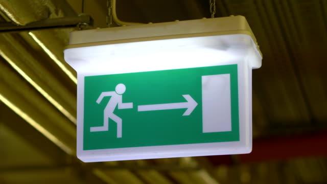 Exit emergency sign in 4K slow motion 60fps video