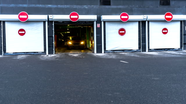 exit of cars from  underground Parking of shopping mall, time lapse video