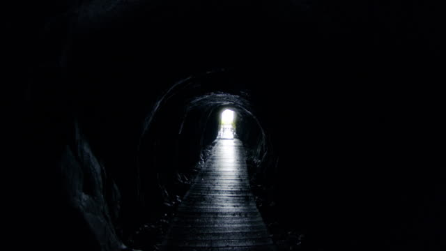 Exiting A Creepy Abandoned Cave Mine This beautiful abandoned mine is located near Karlstad Sweden. tunnel stock videos & royalty-free footage