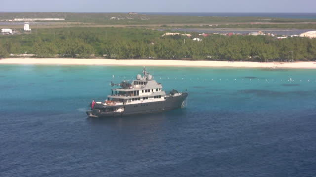 Exotic Caribbean island Luxury yacht carrying  ahelicopter near the Turks and Caicos turks and caicos islands stock videos & royalty-free footage