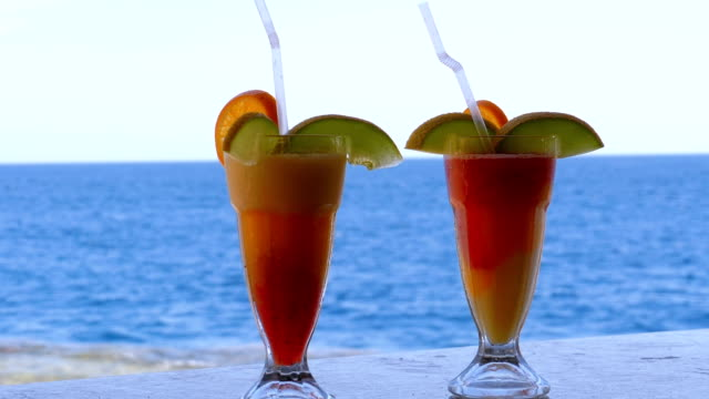 exotic cocktails on the bar counter on the background of the red sea - rum superalcolico video stock e b–roll