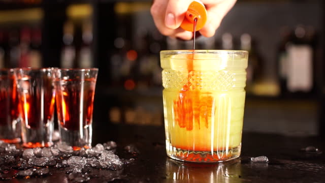 Exotic fruit cocktail in glass isolated on blurred restaurant background