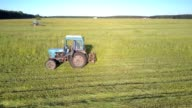 istock experienced driver drives hay baler cutting off grass 1173612408
