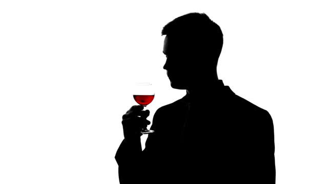 Experienced male taster silhouette drinking old red wine, enjoying bouquet video