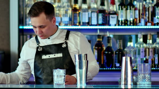Expert barman is making cocktail at night club video