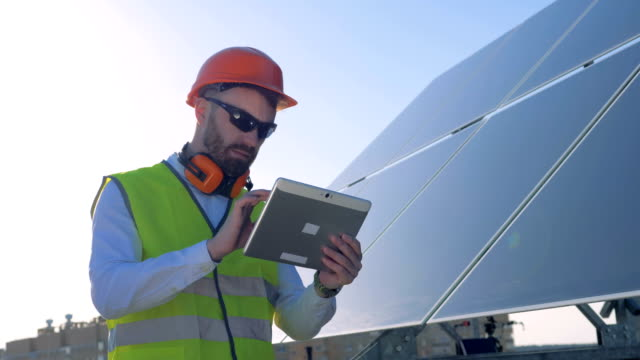 Expert is inspecting quality of a solar panels. Ecology Power Conservation Concept video