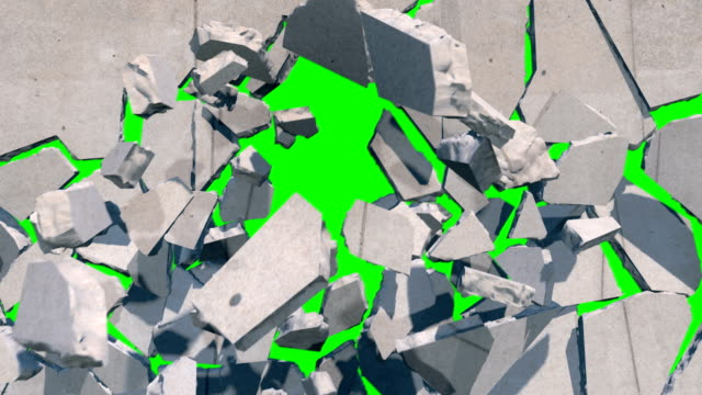 緑色の画面を明らかにコンクリートの壁を崩壊して爆発 - 壁点の映像素材/bロール