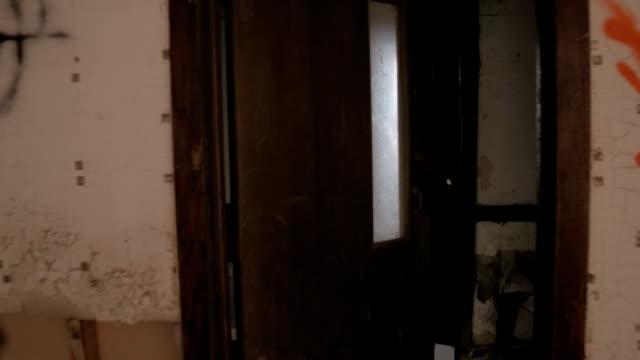 POV: Exploring abandoned demolished apartment block with narrow scary corridors
