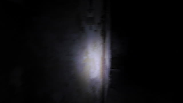 Exploring an abandoned building with torch light video