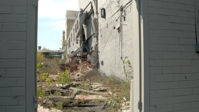 CLOSE UP: Exploring crumbling ruins of abandoned Fisher Body Plant factory, USA video