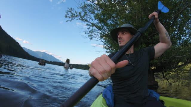 Exploring Nature Lake in Mountain Wilderness Kayaking Face Shot