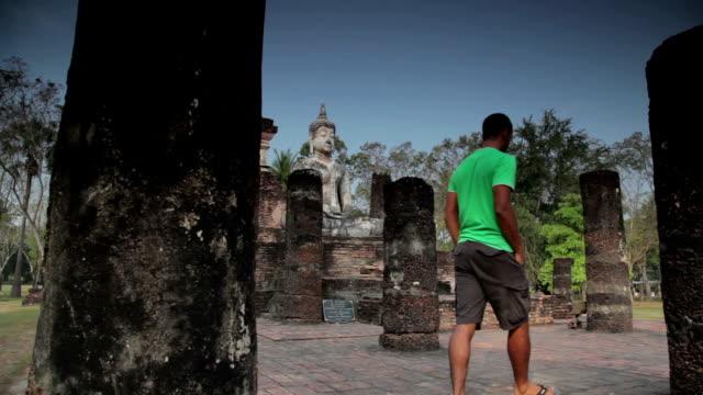 Exploring Temple Ruins in Thailand Exploring Temple Ruins in Thailand Stock Video sukhothai stock videos & royalty-free footage