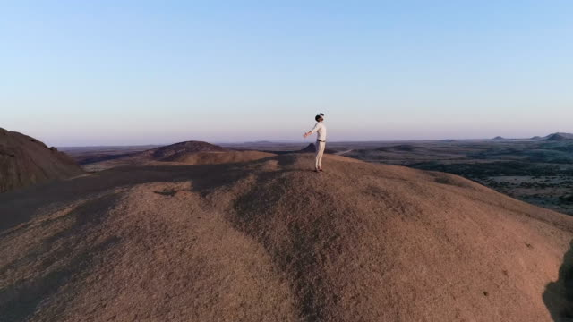 Exploring virtual reality. Man admiring view with open arms video