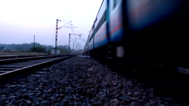 Express train running on railroad track Express train running on railroad track. intercity stock videos & royalty-free footage