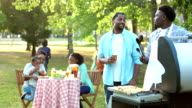 istock Extended African-American family having cookout 958935058