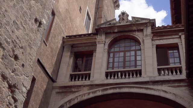 Exterior of beautiful european architecture in center of Rome. Camera moving up in slow motion