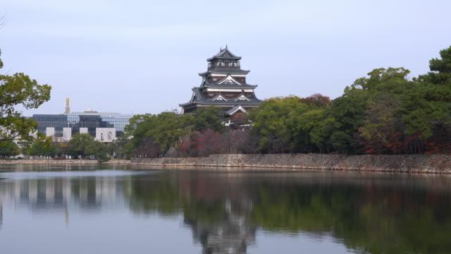 exterior of hiroshima castle 4k video pond reflections japan - hiroshima filmów i materiałów b-roll