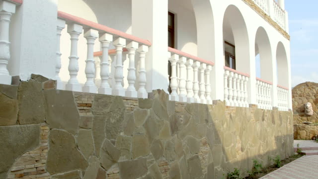 exterior of mediterranean house with traditional white balustrade balcony - balaustrata video stock e b–roll
