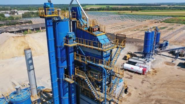 Bидео Exterior of metal building of asphalt plant.
