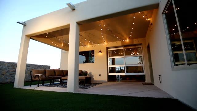 stockvideo's en b-roll-footage met exterieur patio en deur open rising shot - garden house
