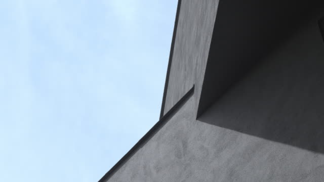 exterior wall of a grey building and sky - abstract architecture стоковые видео и кадры b-roll