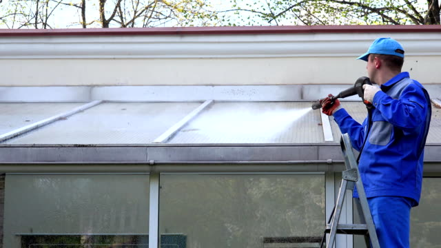 Exterior washing and building cleaning glass roof with high pressure water jet. video