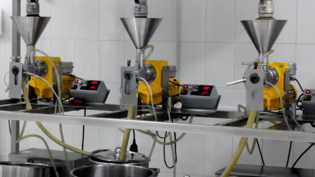 extraction of oils in a factory video