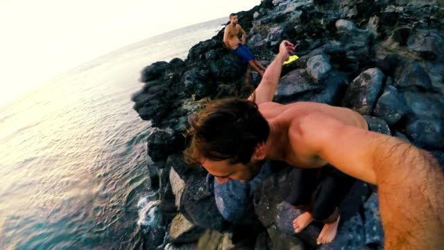 Extreme POV Cliff Jump into Ocean in Hawaii. Extreme POV Cliff Jump into Ocean in Hawaii. Slow Motion. cliff jumping stock videos & royalty-free footage