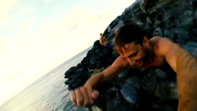 Extreme POV Cliff Jump Extreme POV Cliff Jump into Hawaiian Ocean at Sunset. Fun Point of View. cliff jumping stock videos & royalty-free footage
