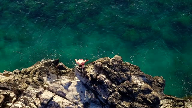 Extreme Cliff Jumping Backflip. Summer Extreme Sports Shot from Above Aerial View. Extreme Cliff Jumping Backflip. Summer Extreme Sports Shot from Above Aerial View. cliff jumping stock videos & royalty-free footage