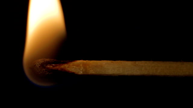 Extreme close up dying match burning wooden with sound video